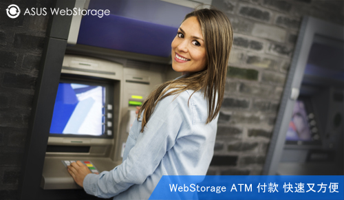 Happy woman withdrawing money from an ATM and looking at the camera smiling